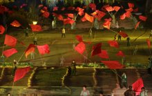 Performers wave large red flags in a large scale live-action show near two theme parks on the outskirts of Wuxiang county in north China's Shanxi province