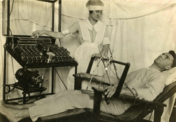 A shell-shocked soldier receives an electrical shock treatment from a nurse. (otis historical archives)
