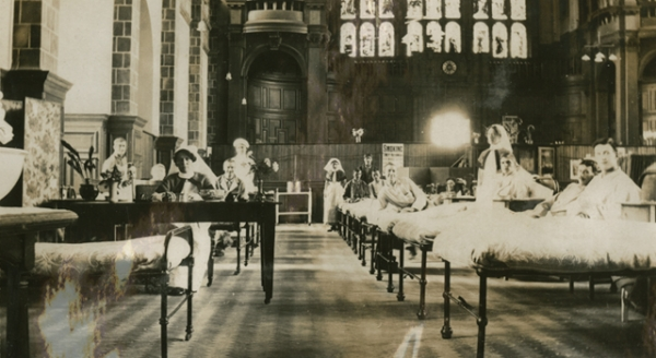 This photograph shows the University of Birmingham's Great Hall converted into a military hospital ward