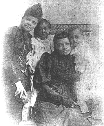 Ida B. Wells with Thomas Moss's family.