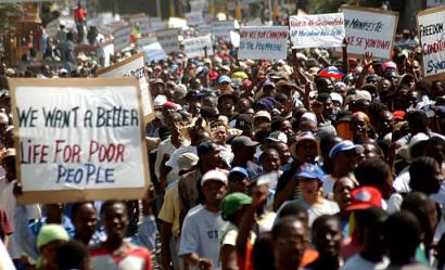 Anti-Aristide protesters march in Port-au-Prince, Haiti, Sunday, February 1st 2004